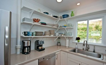 The old, tiny kitchen area beautifully remodeled.