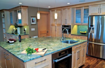 A generous island and prep sink allow the cook to communicate with family and friends during meal preparation