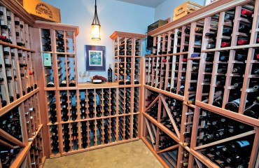 Appropriate storage and humidification help preserve a cherished wine collection. Design Luxe Wine Cellars.