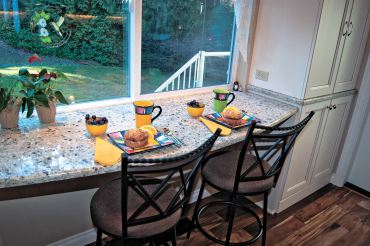 The breakfast bar looks out onto the backyard. It's also the right size for a buffet when entertaining.
