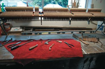 Below: A piano stack in process of repair