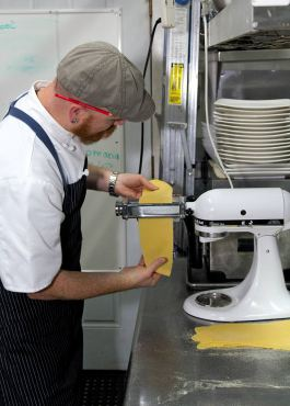 Chef Lyman preparing pasta