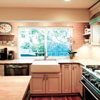 Country-style cabinetry with painted and glazed finish (Photo courtesy A Kitchen That Works)