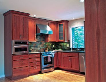 Transitional-style cabinetry with stained cherry finish. (Photo courtesy A Kitchen That Works)