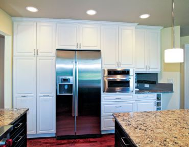 Traditional-style cabinetry with painted finish. (Photo courtesy A Kitchen That Works)