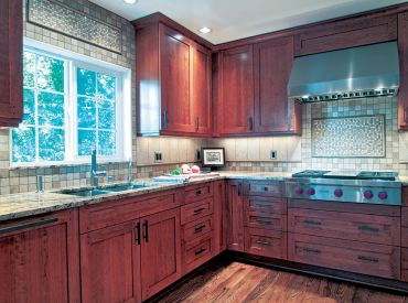 Crown, double light valance, toe skin and show molding lend a decorative flair to this transitional kitchen. (Photo courtesy A Kitchen That Works)