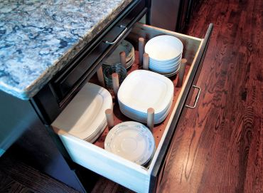 Peg board dish storage. (Photo courtesy A Kitchen That Works)
