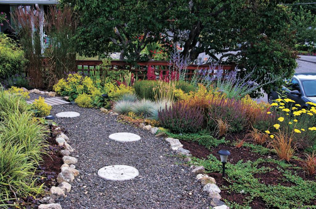 Blue Fescue, Purple Salvia, Yarrow, Russian Sage And Other Low Growing  Plants Mingle In The Front Garden. (Photo Courtesy Colleen Miko)