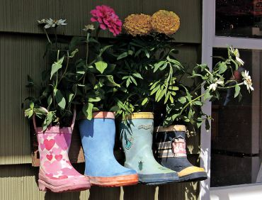 Colorful garden boots, planted with cheerful, annual flowers, make visitors smile. (Photo courtesy Colleen Miko)