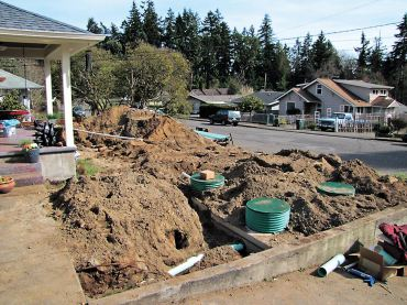The front yard during installation of the new septic system. (Photo courtesy Jean Clark)