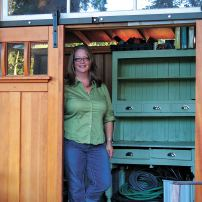 "Jean with her heirloom ""kitchen queen"" cabinet that holds reign over the shed. (Photo courtesy Colleen Miko)"