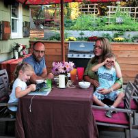 The Clarks enjoy a warm evening outside with a snack at the patio table. (Photo courtesy Colleen Miko)