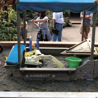 "The ""sandboat"" was a hit for the 2012 Manette Edible Garden Tour. When Sydney and Samson outgrew the sand box, the area was repurposed for a firebowl to sit around on cool nights. (Photo courtesy Colleen Miko)"