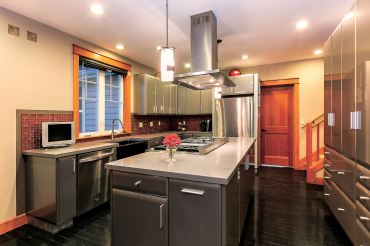 The stainless steel kitchen has everything for the family chef