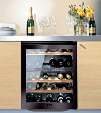 Miele wine refrigerator model No. KWT4154 is sleek and tucks nicely under a standard-height countertop with 38-bottle storage capacity and two temperature zones for red and white wine storage.