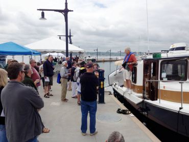 Visitors listen to a presenter at last year's National Marina Day.