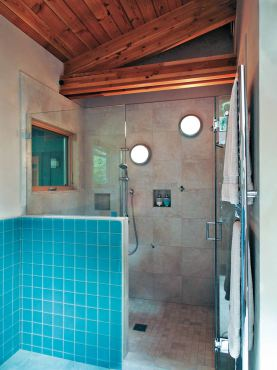 The fixtures featured in this shower were designed for the outdoors. The car decking on the ceiling necessitated wall mounting the fixtures in the shower. (Photo courtesy A Kitchen That Works, LLC)