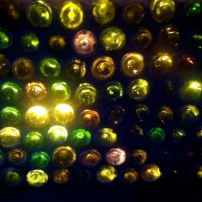 "This is our ""recycled wine bottle wall,"" all lit up at the base of our deck/patio stairs."