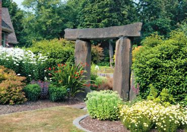 Three humongous stones serve as an entryway into the most floriferous part of the garden