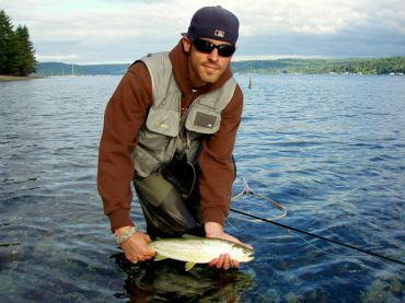 A fly angler prepares to release a one of Puget Sound's treasures: a wild sea run cutthroat.