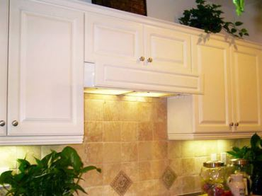 A retractable, flush-mount range hood made by Imperial Kitchen