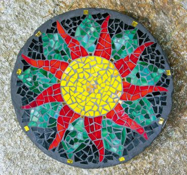 Completed sunflower stepping stone, with sealant applied.