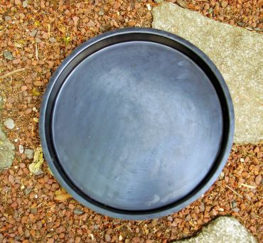 Plastic mold for pouring your own concrete stepping stone.