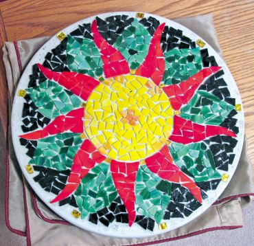 Stepping stone after glass is glued on, but before grouting.
