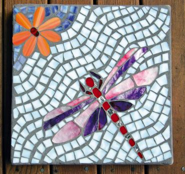 Delightful dragonfly stepping stone was a gift to the author from Louise Martin.