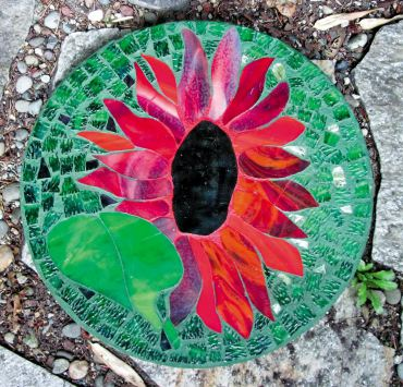 On this sunflower pattern, Louise painted the grout with DecoArt patio paint to achieve a two-tone look.