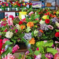 A rainbow of bouquets all ready for the Garden Party are the results of days' worth of work for Cathy Tyler and her talented volunteers.