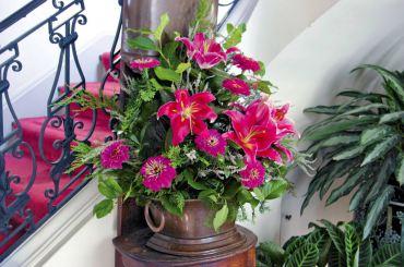 An elegant summertime display features fragrant oriental lilies, zinnias, salal, heather and cedar.
