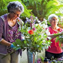 Maryann Malabon and Ernestine Schwartzman enjoy the fresh air and the creative spirit that surrounds preparations for the Garden Party.