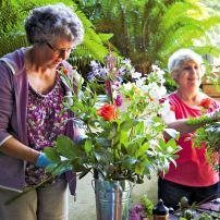 Maryann Malabon and Ernestine Schwartzman enjoy the fresh air and the creative spirit that surrounds preparations for the Garden Party.