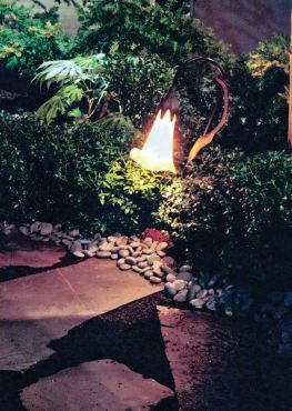 Landscape lighting illuminates pathways for moonlight strolls through the garden.