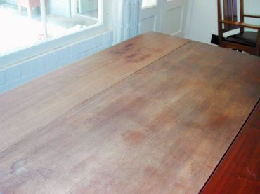 The drop-leaf table before being restored.