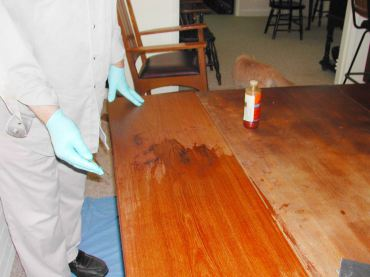 It took about an hour of light sanding, oiling and wiping off with a cloth to get the table back to its color.