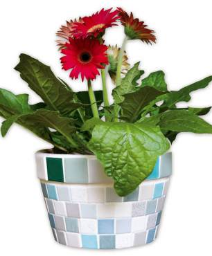 A cache pot of variegated 1- and 2-inch tiles eliminates the need for breaking tile.