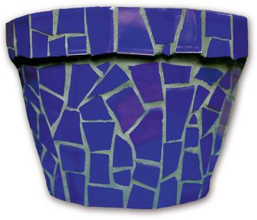 Green grout emphasizes the irregular shapes of broken blue tile