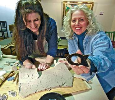 Jessica Loescher and Terry Logan sharing clay and napkin ring techniques.