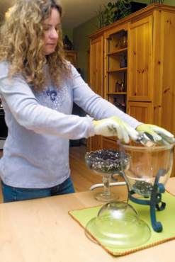 "Colleen Miko, ""The Creative Gardener,"" plants a terrarium."