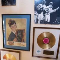 Jini Dellaccio's photo of Valley with the Raiders in 1967 and two of Valley's gold records decorate a wall.