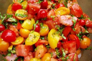 Cherry tomato bruschetta: tomatoes, basil, olive oil, balsamic vinegar, salt, pepper and (sometimes) garlic