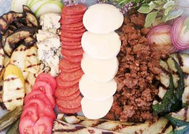 Fresh Pizza Ingredients: Grilled red onions, grilled green and yellow zucchini, jalapenos, tomato, pear, Stilton cheese, pepperoni, fresh mozzarella, and Italian sausage.