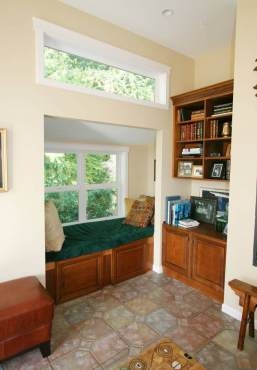 A space that may normally be unused became a cozy reading nook in this client home.