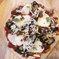 Zucchini, Italian sausage, pepperoni, fresh mozzarella, and basil pizza (before baking).