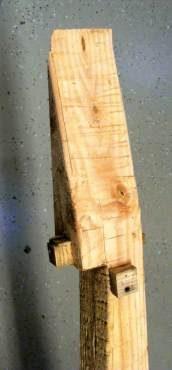 The top of the untreated post is cut at sharp angles where it will meet the roof of the box to allow room for bats to roost. (Photo by Carol McGhee)