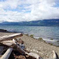 """The beach at Guillemot Cove Nature Reserve, which is owned by Kitsap County, can be accessed through one of the trails and has beautiful views of """"the Brothers."""" (Photo by Rodika Tollefson)"""