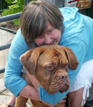 Lisa Infante with her French mastiff, Layla. (Photo by Carol Infante)