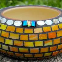 Infante loves bright, warm colors of stained glass, as featured on this utilitarian bowl. (Photo by Colleen Miko)